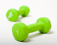 The two green Dumbbells isolated on the white backing Stock Images
