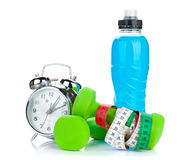 Two green dumbells, tape measure, drink bottle and alarm clock Royalty Free Stock Photos