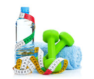 Two green dumbells, tape measure and drink bottle. Fitness and h Stock Photos