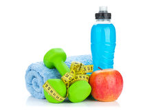 Two green dumbells, tape measure and drink bottle. Fitness and h Stock Photo
