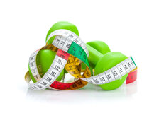 Two green dumbells and tape measure. Fitness and health Stock Image
