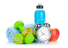 Two green dumbells, tape measure, healthy food and alarm clock Stock Photos