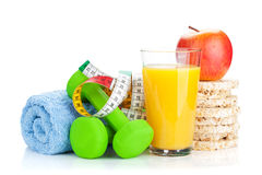 Two green dumbells, tape measure and healthy food. Fitness and h Stock Photos