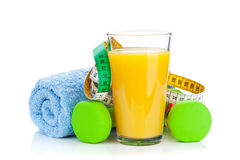 Two green dumbells, tape measure and orange juice. Fitness and h Royalty Free Stock Images