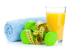 Two green dumbells, tape measure and orange juice. Fitness and h royalty free stock image