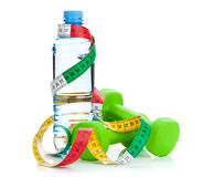 Two green dumbells, tape measure and water bottle Royalty Free Stock Photography