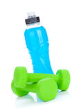 Two green dumbells and water bottle Royalty Free Stock Images
