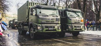 Two Green Dump Trucks on Gray Concrete Road Stock Images