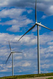 Two Green Energy Industrial Wind Turbines in Oklahoma. Two Huge High Tech Industrial Wind Turbines Generating Environmentally Sustainable Clean Electricity in Stock Photography