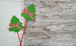 Two green fir tree on the linen cloth and old wood Royalty Free Stock Photos