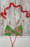 Two green fir tree with ribbon on the old wood background Stock Photo