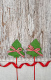 Two green fir tree with ribbon on the old wood background Royalty Free Stock Image