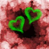 Two green flying hearts made of smoke over cloud background.  Stock Photos