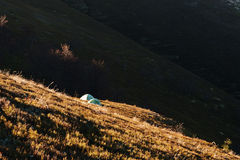 Two green frost camping tent on sunlight of mountains. Stock Photography