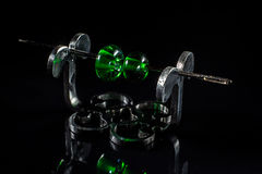 Two green glass beads on stand Royalty Free Stock Images
