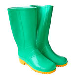 Two green gumboots. For work in a garden on a white background Royalty Free Stock Image