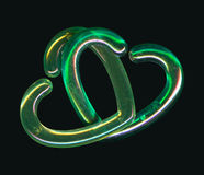 Two Green Interlocking Hearts. Two green transparent interlocking heart shapes Royalty Free Stock Photos