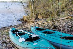 Two green kayaks Stock Photography