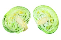 Two green leafy cabbage halves on white background isolated close up, cutted pieces of ripe white cabbage head stock photography