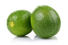 Two green lime on white background. Two green lime isolated on white background stock images