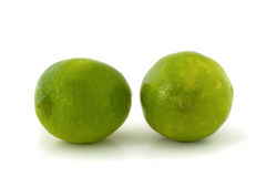 Two green limes. Isolated on white background Stock Photography