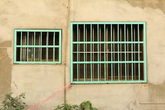 Two of Green Metal Barred Window. Built to Protect House from Robber in Asian Style Royalty Free Stock Image
