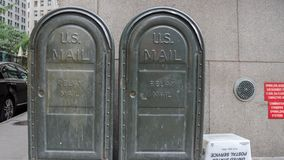 Two green old usa mail boxs nyc. Us mail boxes in the street stock photo