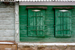 Two green old wooden window in a painted wall Royalty Free Stock Images