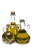 Two green olives and three bottles. Royalty Free Stock Photography