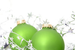 Two green ornaments with silver stars Stock Photography