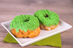 Two green pearled spritz biscuits Royalty Free Stock Image