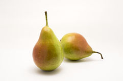 Two green pears over white background Royalty Free Stock Photos
