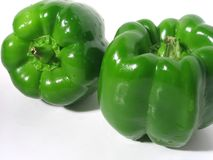 Two Green Peppers. Two green bell peppers royalty free stock photo