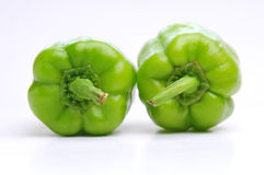 Two Green Peppers in love. Two green pepper on the white background Royalty Free Stock Image