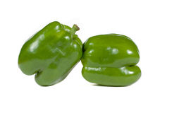 Two green peppers on white Royalty Free Stock Images