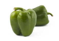 Two green peppers on white background. Two green ripe peppers on white background Royalty Free Stock Photo