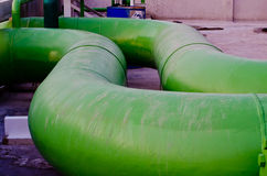 Two green pipes on floor Royalty Free Stock Photo