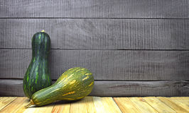 Two Green raw pumpkin on wooden background. Organic products. Royalty Free Stock Photography