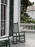 Two green rocking chairs Stock Photos