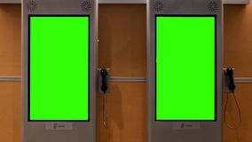 Two green screens for your ad. At YVR airport stock video