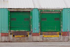 Two green shuttered outside loading gate ramps Stock Images