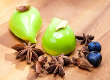 Two green small appetizing cakes and spices lie on a wooden tray Stock Image