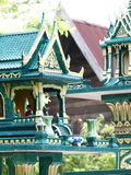 Two green spirit house in thailand with flower vases Stock Images