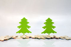 Two green spruce wooden puzzles Stock Images