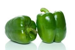 Two green sweet peppers. Isolated on the white background Stock Photo