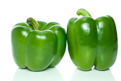 Two green sweet peppers. Isolated on the white background Royalty Free Stock Image