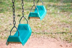 Two green swing for kids playing. Green swing for kids playing Royalty Free Stock Photography