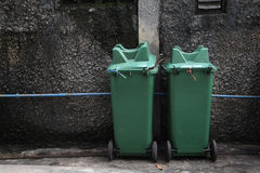 Two green trash near grunge wall Royalty Free Stock Photography