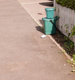 Two green waste food recycling boxes on front path Royalty Free Stock Photography