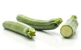Fresh Green Zucchini isolated on white. Two green zucchini with one sliced half isolated on white background long raw courgettes Stock Image